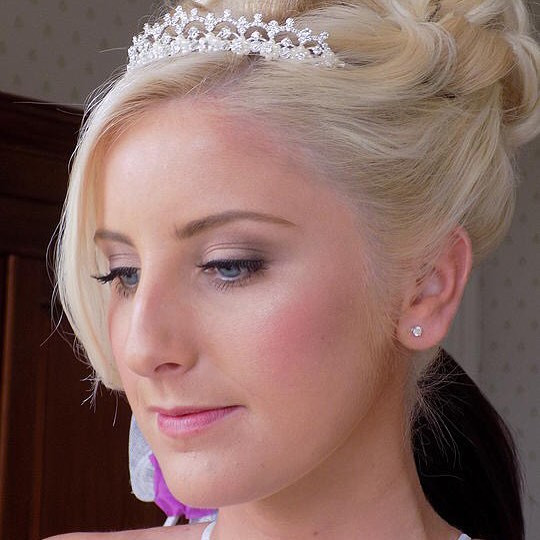 - Make Me Bridal Artist: Genevieve Satha Makeup.