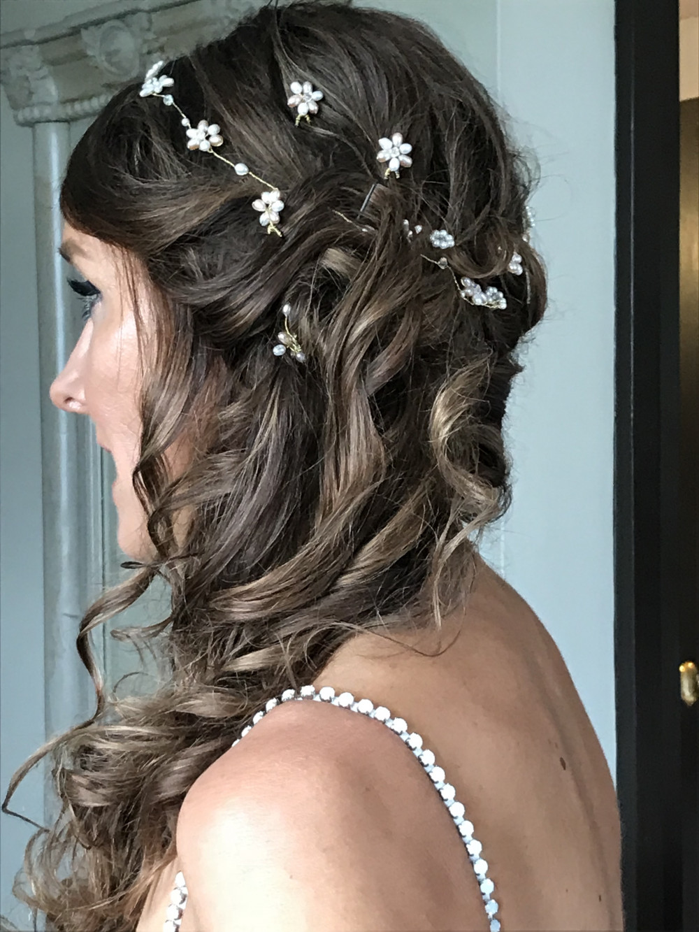 Gorgeous glossy looking half up half down do for this brunette. The hair vine really set off the look. - Make Me Bridal Artist: Barnet & Boatrace. Photography by: Barnet & Boatrace own. #hairvine #brunette #halfuphalfdown