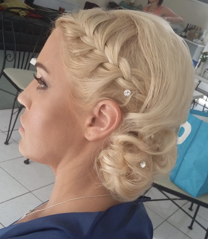 This gorgeous bridesmaid in the aesthetic trade simply loved having her hair and makeup done and was very specific about her requirements! We gave her a glamorous up do and bold makeup. We exceeded her expectations and she has re-booked Tandee for a future event! - Make Me Bridal Artist: Barnet & Boatrace. Photography by: Barnet & Boatrace's own. #blonde #bridesmaidhair #plaitedupdo