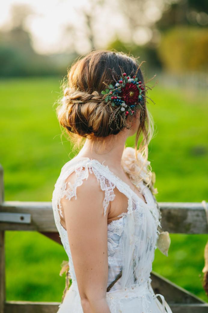 Rolled undo with braid and floral accessory - Make Me Bridal Artist: The studio effect . Photography by: Richard wakefield. #bridalhair #flowersinherhair #rustic #lowupdo #relaxedupdo #braidedupdo #flowers #bohobride #undoneupdo #countrywedding #floralaccessory #outdoorwedding