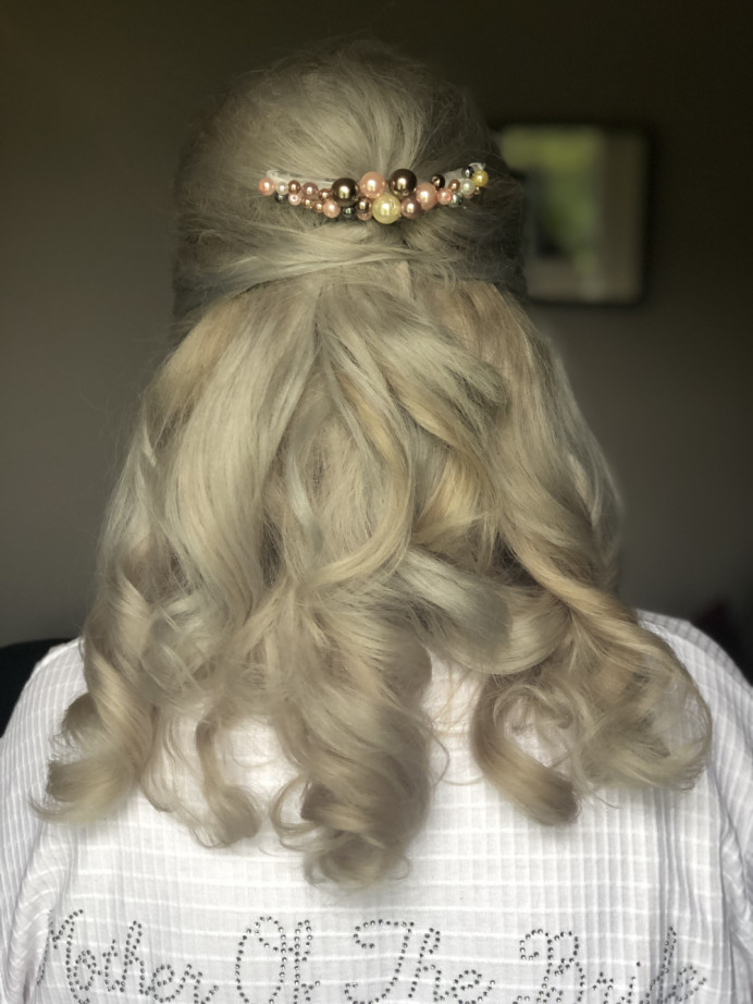 Mother of the groom beehive curly hair half up half down with a hand made accessory - Make Me Bridal Artist: The studio effect . #beehive #motherofthebridemakeup #glammum #motherofthegroom #motherofthebridehair