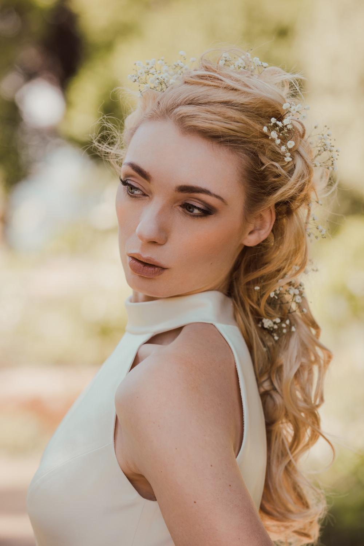 Stunning Kat modelling a La novia gown in the grounds on Lauriston Castle, Edinburgh - Make Me Bridal Artist: V M hair and makeup. Photography by: Ian Vincent. #bridalmakeup #bridalhair #flowersinherhair #elegant #romantichairup #smokeyeye #summerwedding