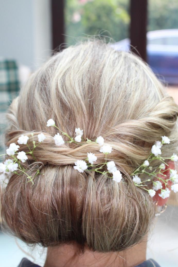 - Make Me Bridal Artist: Hannah Makeup . #flowersinherhair #relaxedupdo