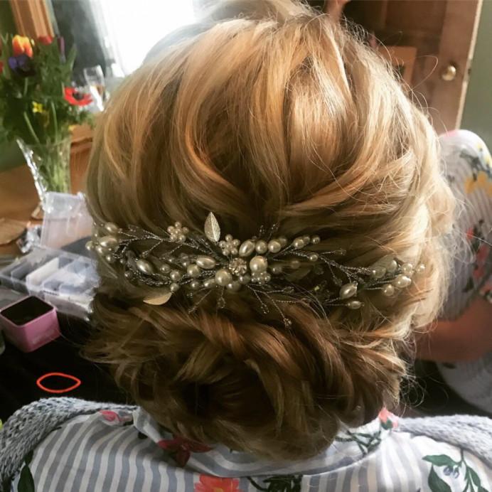 - Make Me Bridal Artist: Lolo & Co.. Photography by: Jennifer Lo. #bohemian #boho #classy #bohobride #eleganthair #texturedupdo #looseupdo