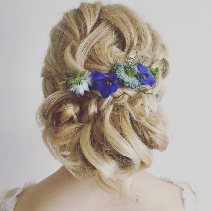 A great tousled, romantic bridal style. Soft and pretty. - Make Me Bridal Artist: Wild Rose Hair . #boho #bridalhair #flowersinherhair #soft #lowupdo #relaxedupdo #romantichairup