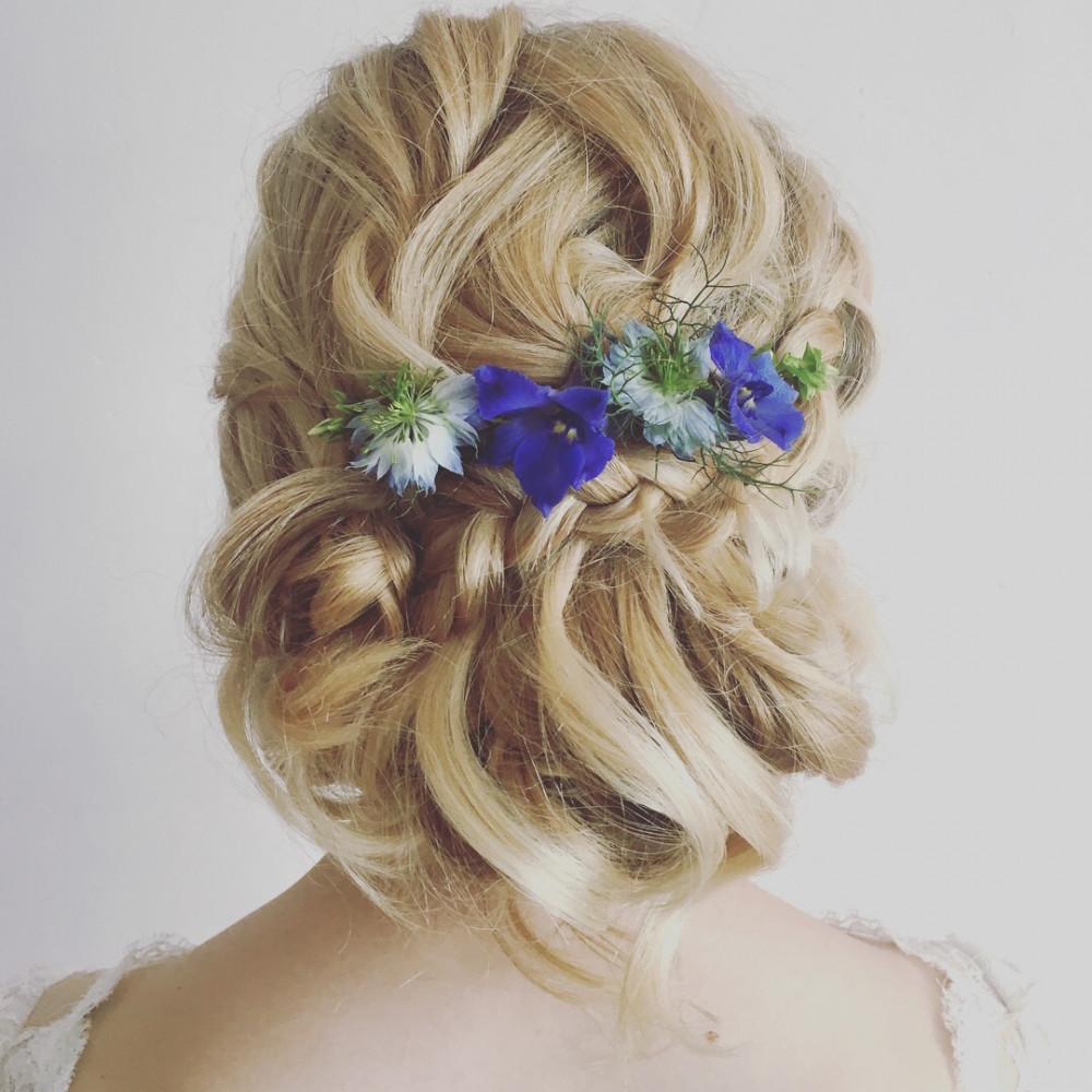 A great tousled, romantic bridal style. Soft and pretty. - Make Me Bridal Artist: Wild Rose Hair . #boho #bridalhair #flowersinherhair #soft #lowupdo #relaxedupdo #romantichairup