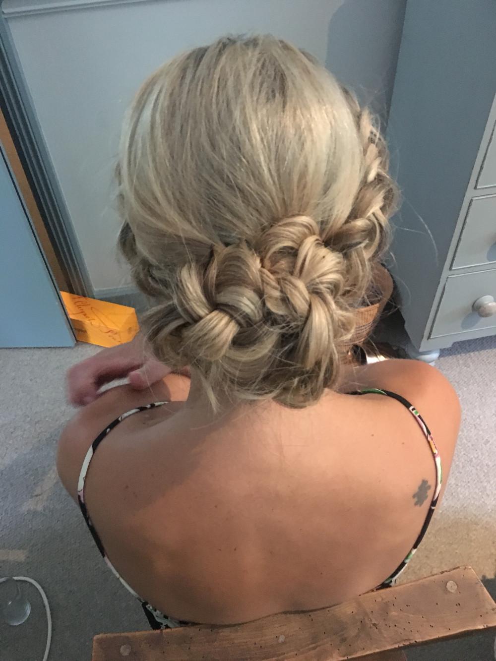 Braided low bun with Dutch braids either side - Make Me Bridal Artist: Wild Rose Hair . #boho #braid #braidedupdo #lowbun #weddinghair