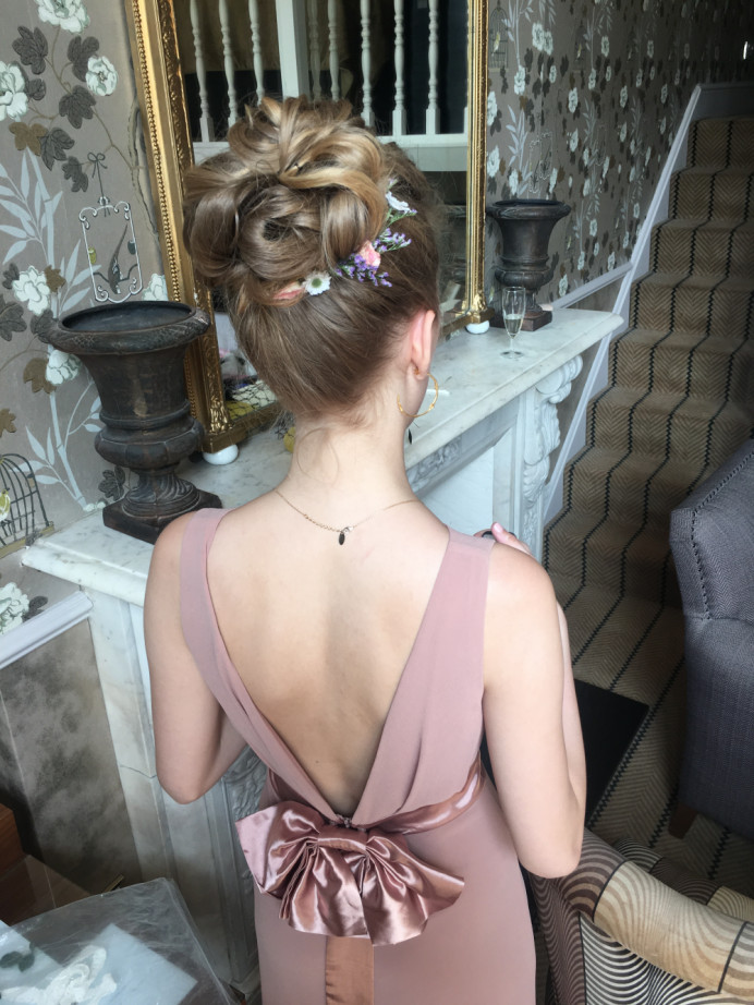 A high bun for an ultra glam look - Make Me Bridal Artist: Wild Rose Hair . #glamorous #updo #hairup #bridesmaidhair #highbun