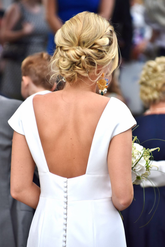 A relaxed low bun with an elegant look - Make Me Bridal Artist: Wild Rose Hair . #boho #bridalhair #lowupdo #relaxedupdo #messybun