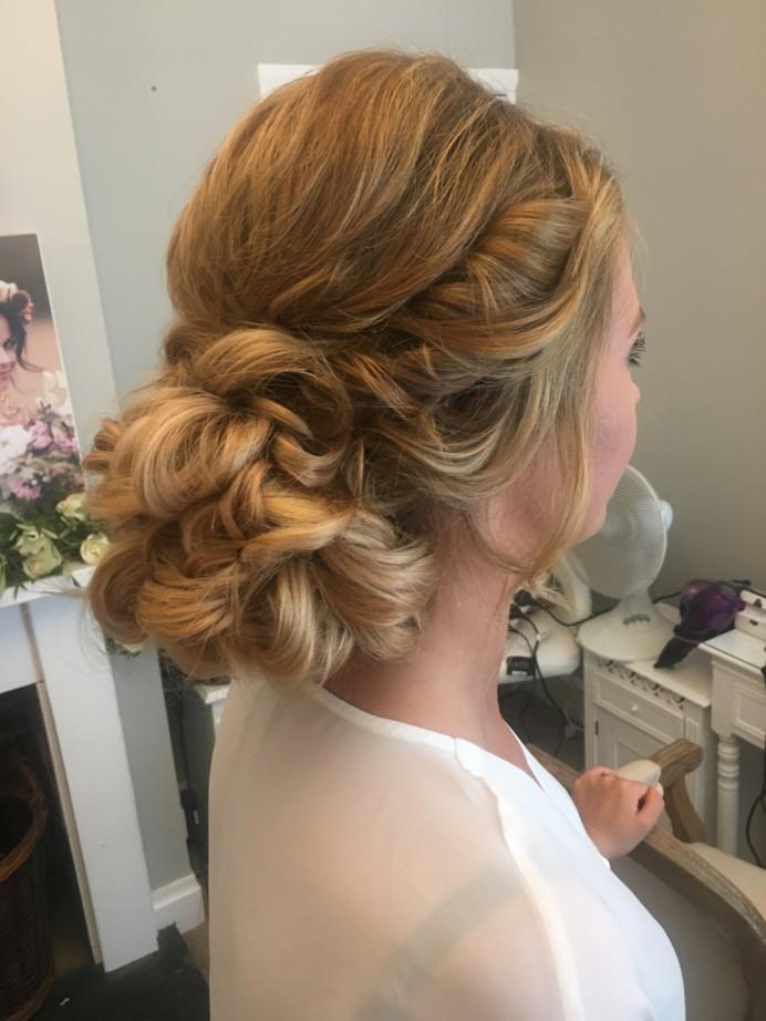 A really beautiful big hair bun. Perfect for any bride - Make Me Bridal Artist: Wild Rose Hair . #bridalhair #updo #lowupdo #fullbun