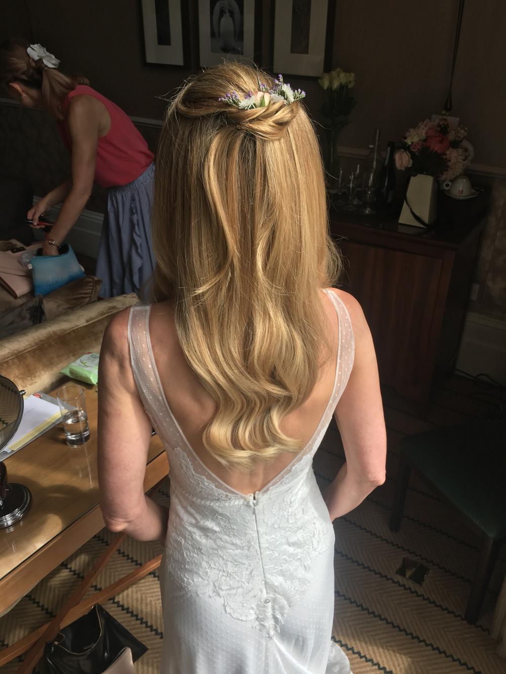 Beautiful half up hair with smooth curls - Make Me Bridal Artist: Wild Rose Hair . #boho #halfuphair #flowersinherhair #smoothcurls #bridalhair