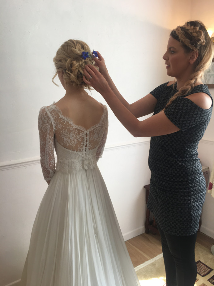 Doing what I do best ! Hard at work and adding finishing touches to my bridal style - Make Me Bridal Artist: Wild Rose Hair . #meatwork #bridalhair #bridalhairstylist