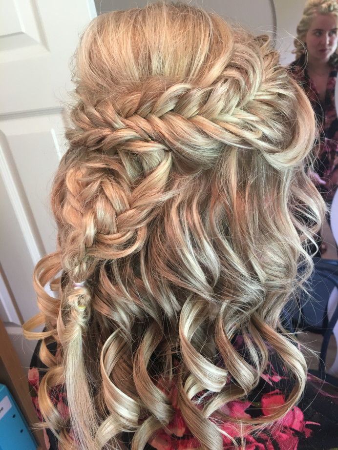 Fishtail braids with a relaxed half up style - Make Me Bridal Artist: Wild Rose Hair . #halfuphair #curls #bridalhair #fishtailbraid