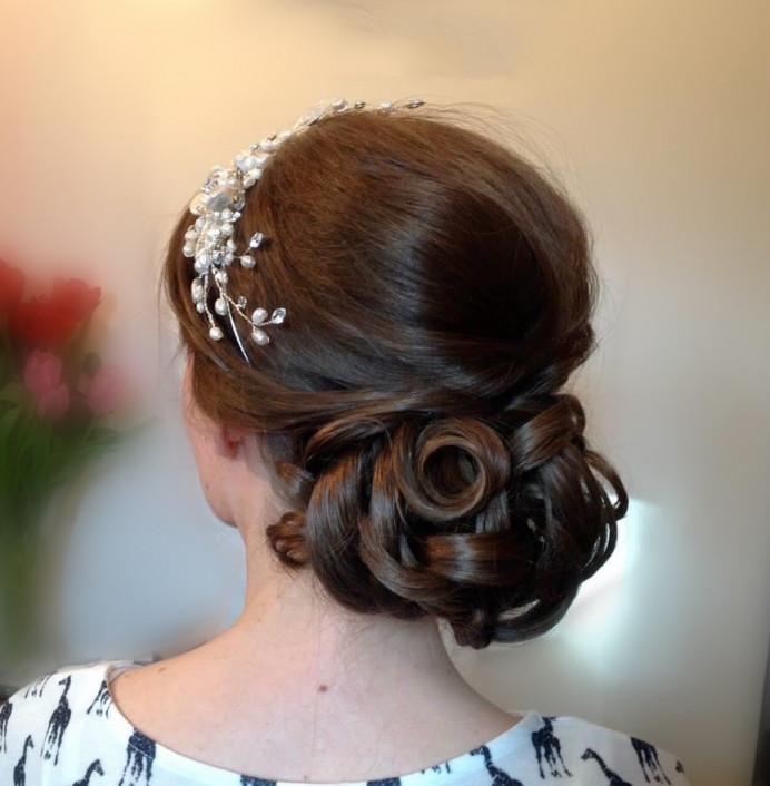 Traditional low bun available under CJ Directors package or Diamond Package - Make Me Bridal Artist: CJ Beauty & Co. #bohemian #classic #vintage #glamorous #boho #hairup #lowbun #bridalhairup #brideshair #romanticupdo #romantichair