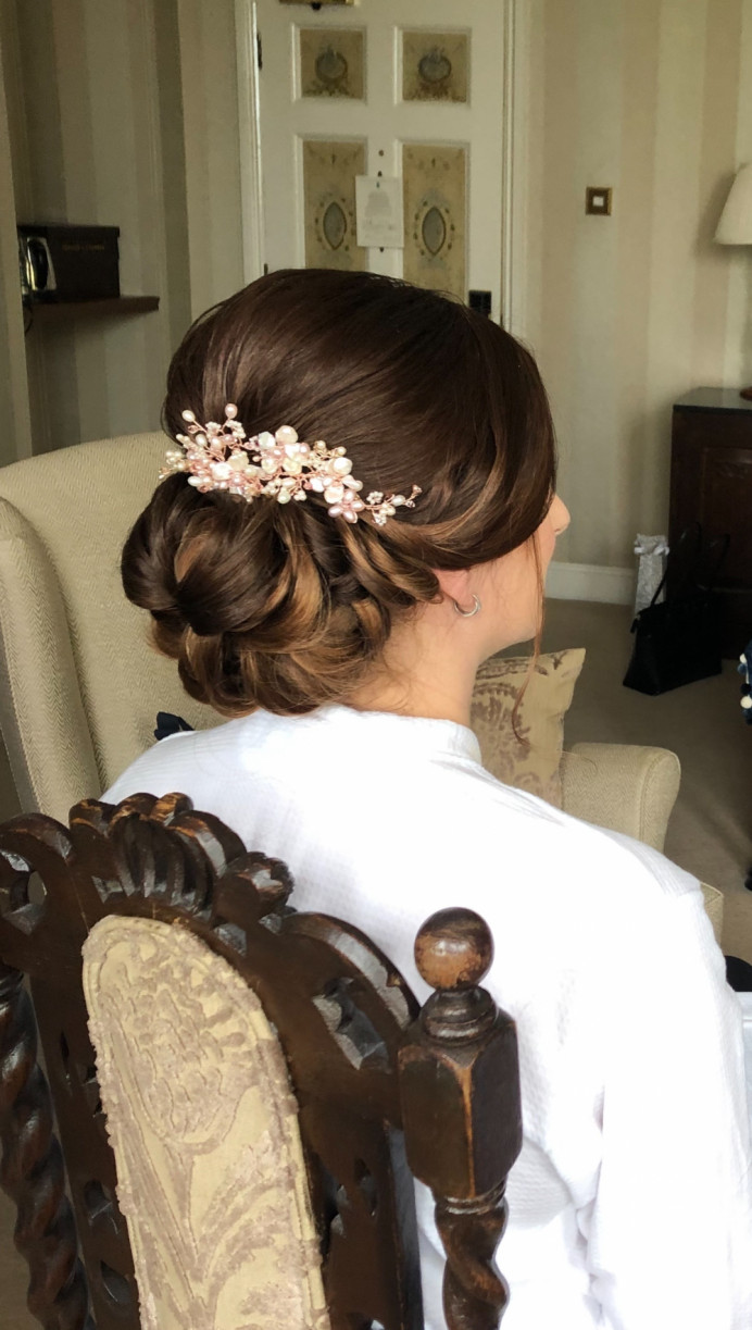 Low bun by our Diamond Team - Make Me Bridal Artist: CJ Beauty & Co. #classic #vintage #glamorous #bridalhair #bridalhairstylist #lowbun #weddinghairup #brideshair #hairvine #hairideas