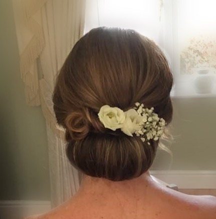 Simple Chignon with our Diamond or Sparkle team - Make Me Bridal Artist: CJ Beauty & Co. #classic #vintage #boho #flowersinherhair #chignon #bridalhair #brideshair #bridesmaidshair #lowchignon