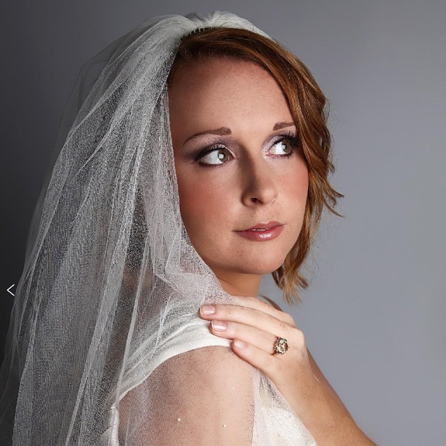 Lucy wanted a fresh and natural make up, but especially wanted emphasis on her eyes. To compliment her skin tone and hair colour, we used plum shadow colours on the eye lids and a rich purple eyeliner. - Make Me Bridal Artist: Beckie Welfare Hair & Makeup.