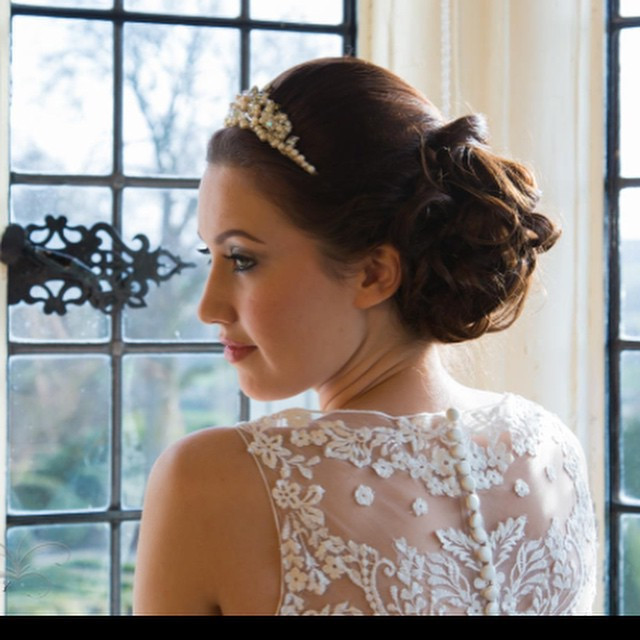 A classic up-do, for a classic bride. Creating the right amount of volume behind the tiara is very personal, but also merging it into a classic but un-manicured style to show off the back of this gorgeous dress is imperative. - Make Me Bridal Artist: Beckie Welfare Hair & Makeup.