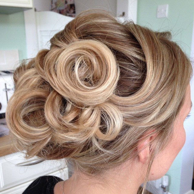 An up-do can be so varied. I loved this style as it was quite different to many others I've done and by letting the hair fall exactly where it wanted we created the circular shapes which we later added diamante pearls to the centres. - Make Me Bridal Artist: Beckie Welfare Hair & Makeup.