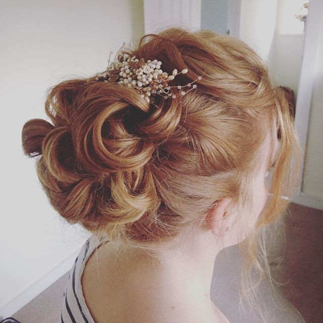 Curling, twisting and looping the hair around itself really worked for this bride and the laid back style we were going for . Her hair piece looked stunning too, as it incorporated amber coloured beads to compliment her natural hair colour, while the pearl beads contrasted delicately.  - Make Me Bridal Artist: Beckie Welfare Hair & Makeup.