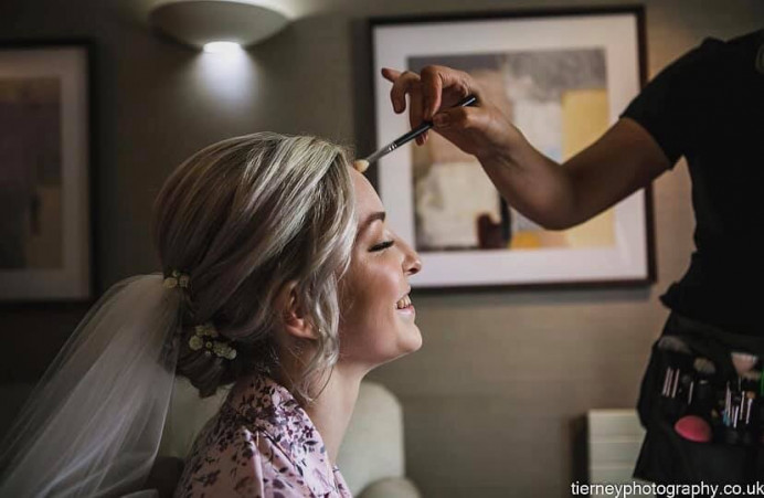 This shot just displays the pure happiness of the bride on her wedding day. It makes me so happy to know that when a bride is in my chair she can feel totally relaxed and can enjoy her wedding morning. - Make Me Bridal Artist: Natasha Jane makeup . Photography by: Mark tierney .