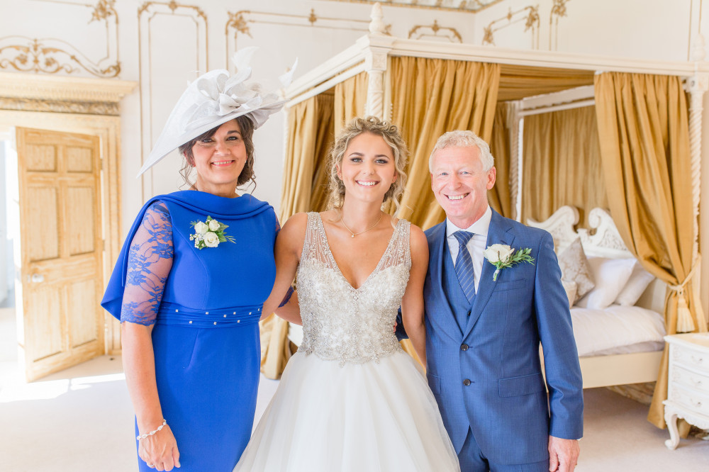 Helena with her mum and dad at Gosfield Hall venue in Essex - Make Me Bridal Artist: Leanne Perilly Make-up Artist. Photography by: Helen. #bridalmakeup #bride #motherofthebride #fatherofthebride