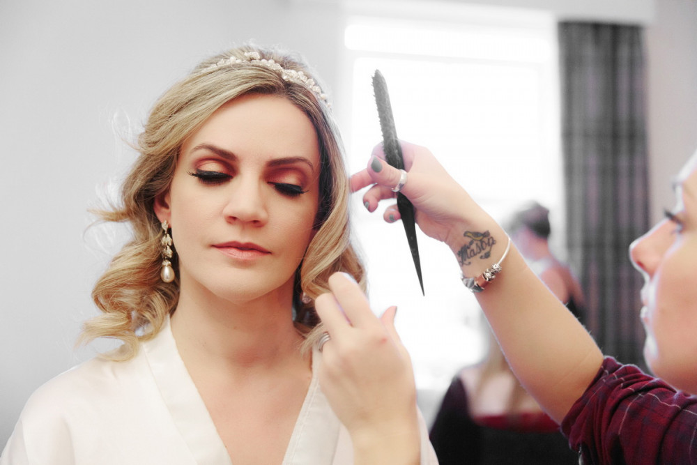 This Bride wanted Autumn colours and a coral lip with large false lashes. - Make Me Bridal Artist: Tania Claire Makeup Artist. Photography by: Steve & Tania Photography. #glamorous #smokeyeyes #bridalmakeup #weddingmakeup #winterwedding #winterweddingmakeup #falselashes #surreymakeupartist #airbrushmakeup