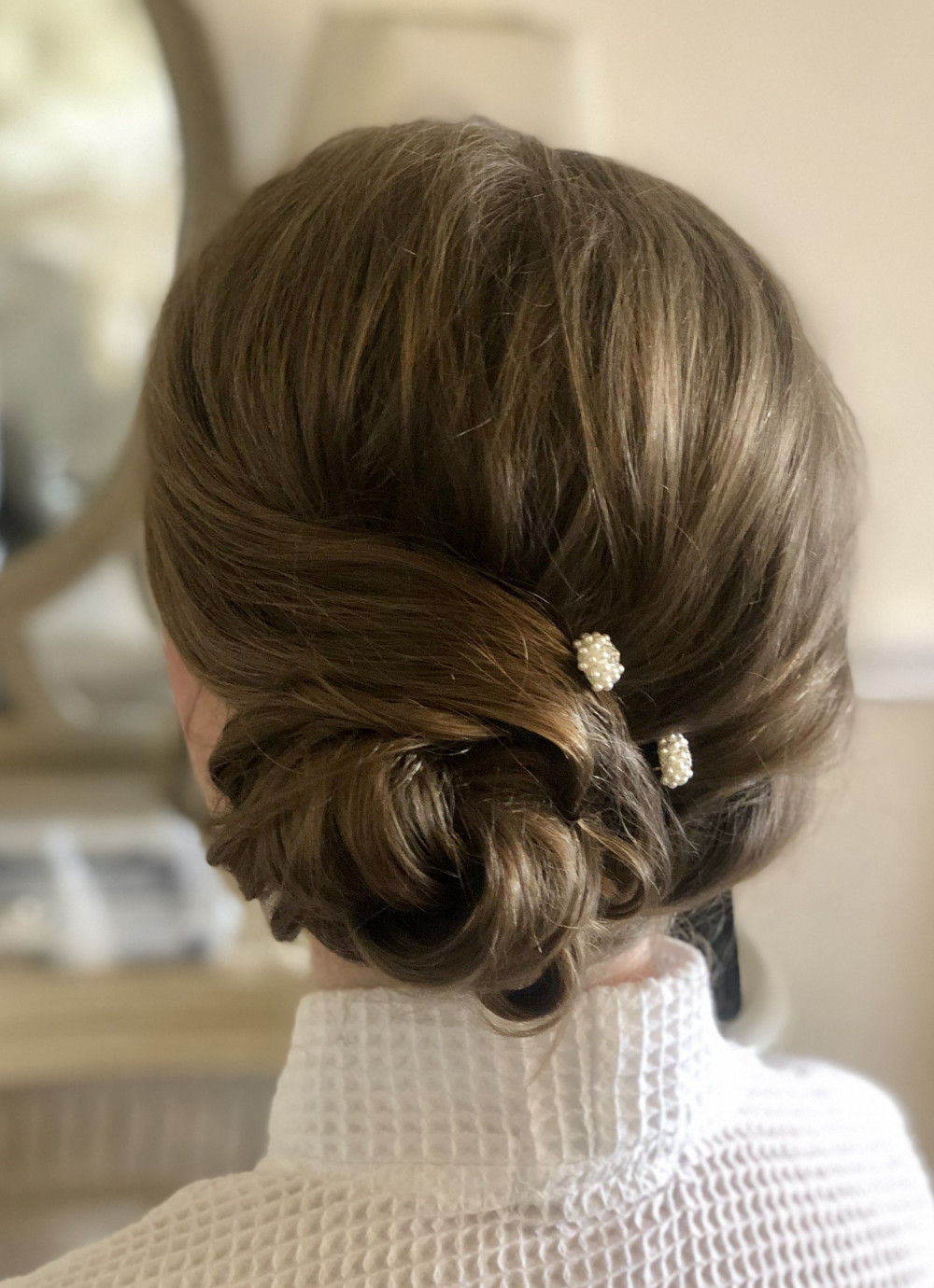 Elegant Bridesmaid side bun - Make Me Bridal Artist: Sarah Clarke Makeup Artist .