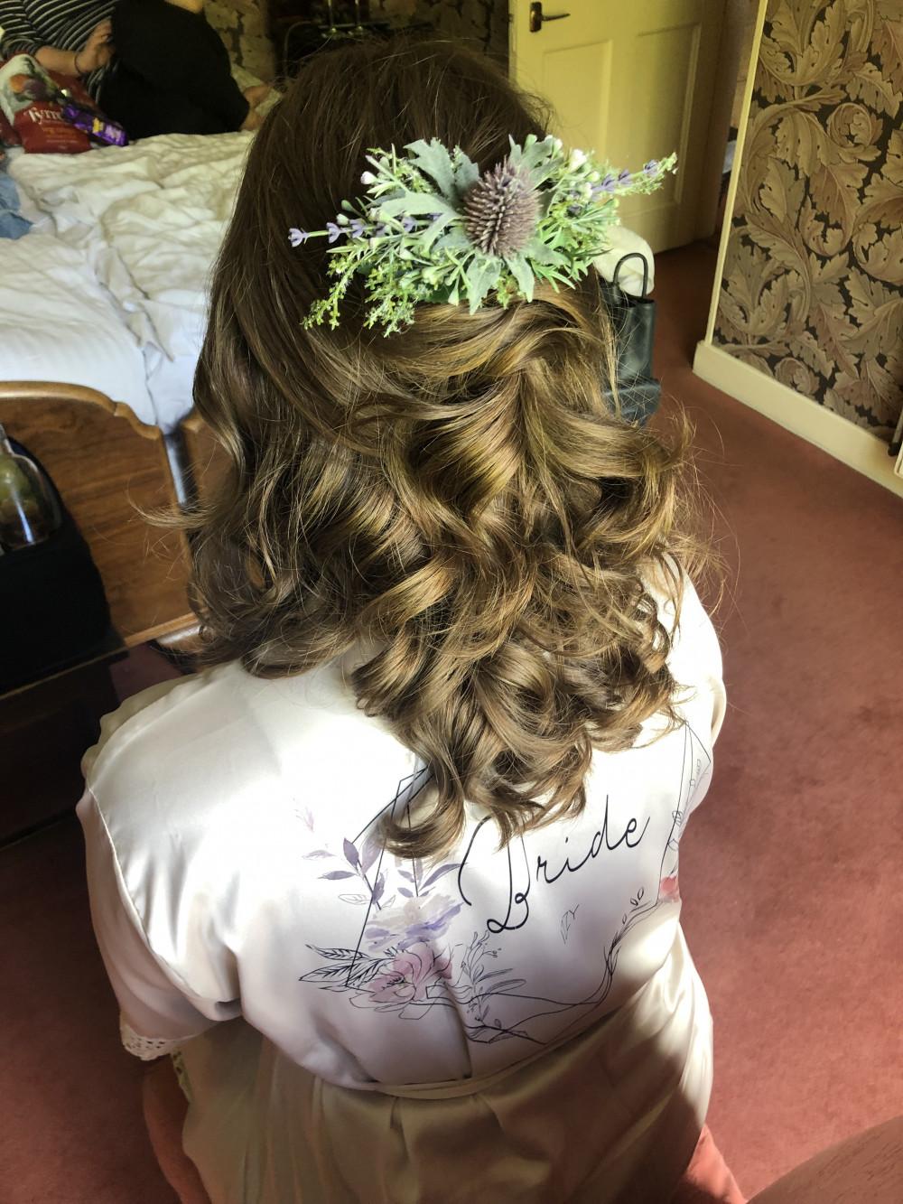 Half Up, half down Bridal Hair Style finished with a very Scottish accessory! - Make Me Bridal Artist: Sarah Clarke Makeup Artist . #curls #bridalhair #loosecurls #brideshair #halfuphair #hairaccessories #twisteddowndo #scottishwedding