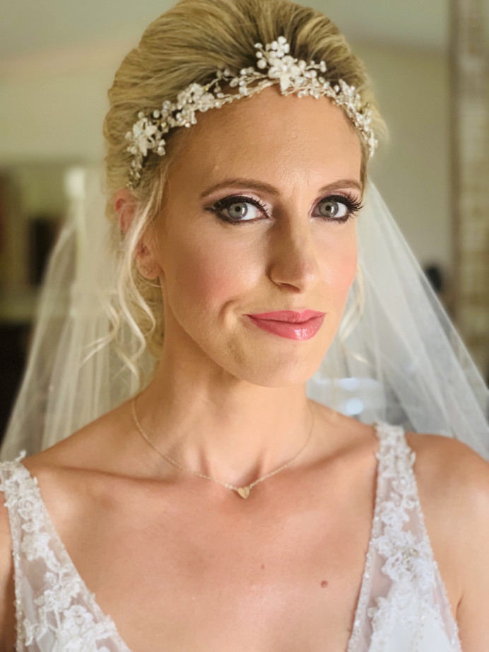 My client requested a mermaid hair style and glamours makeup . Ellie really new what she wanted with her makeup and picked every colour and loved a stronger glamour eye . 