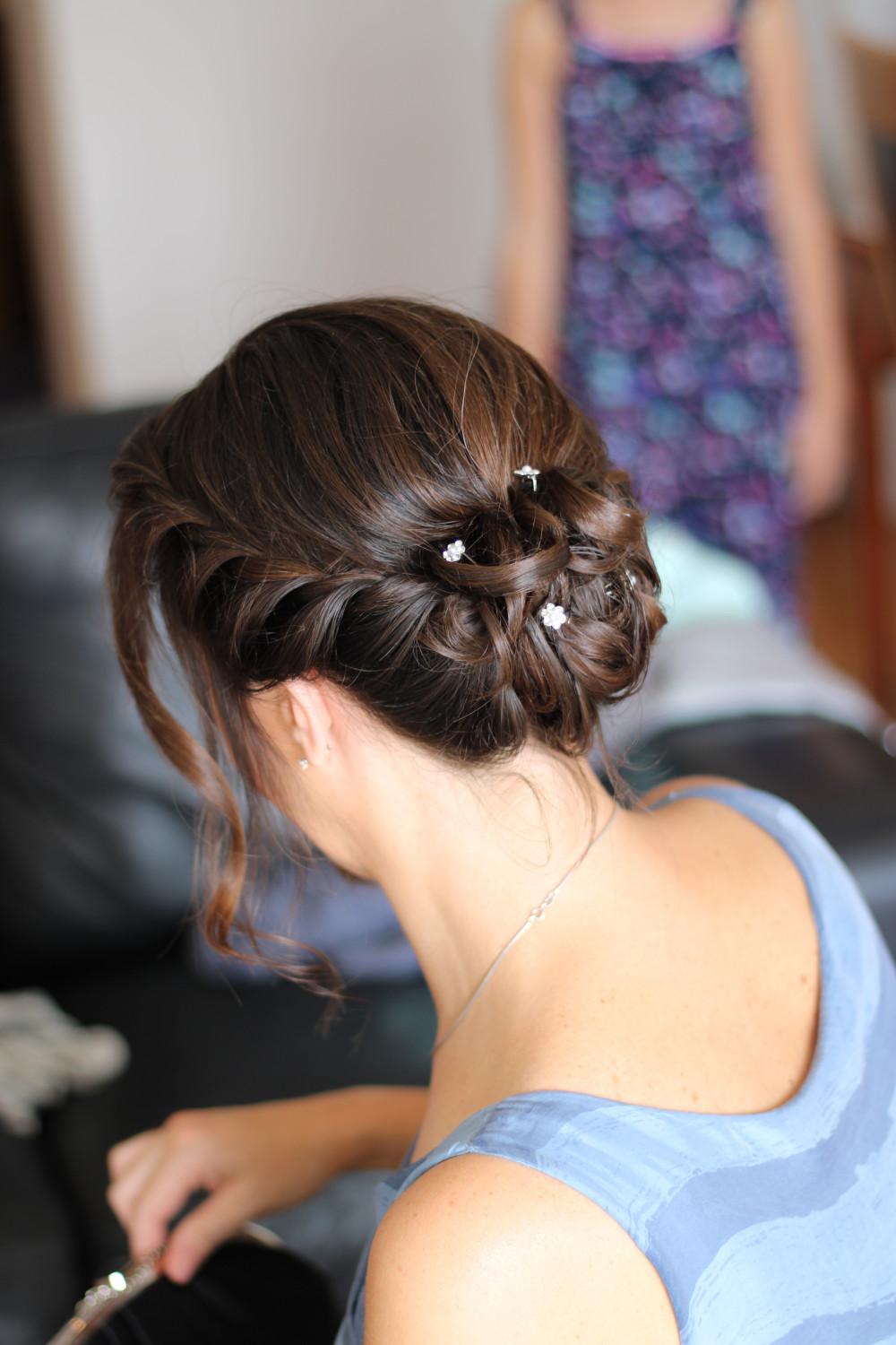 A simple but really effective way of putting up shorter hair and this bridesmaid had pretty pins to accessorise it with - Make Me Bridal Artist: Kimberly Holland Bridal Hair & Makeup Artist. Photography by: Kimberly Holland. #bridalhair #bridalhairstylist #bridesmaidhair #soft #romantic #shorthair #twistedupdo #simplehair