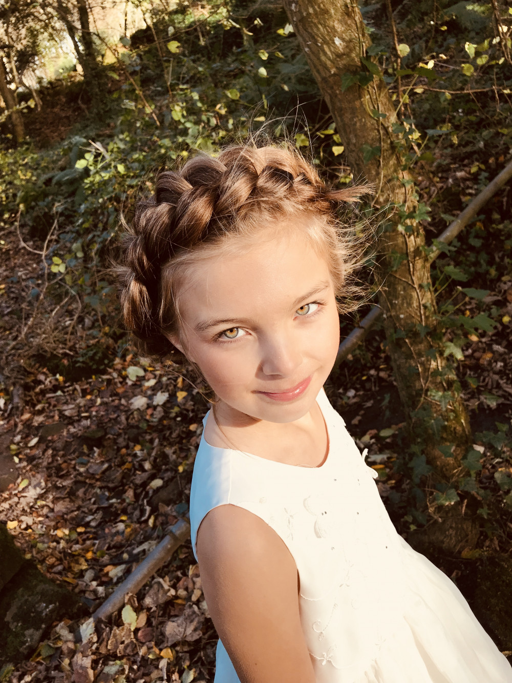 This style using Dutch braid will look beautiful on brides and bridesmaids alike and can be accessorised in so many ways. It can be done on most lengths of hair also - Make Me Bridal Artist: Kimberly Holland Bridal Hair & Makeup Artist. Photography by: Kimberly Holland. #boho #bridalhair #braid #bridesmaidhair #bohobride #updo #plaitupdo #braidedupdo #flowergirl