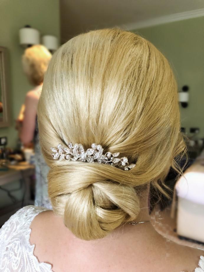 - Make Me Bridal Artist: Rebecca Haines Makeup and Hair. Photography by: Me. #bridalhair #bridesmaidhair #lowbun #weddinghair #classichair