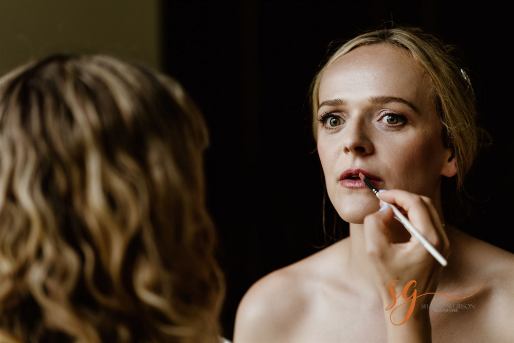 - Make Me Bridal Artist: Amy Laney Makeup.