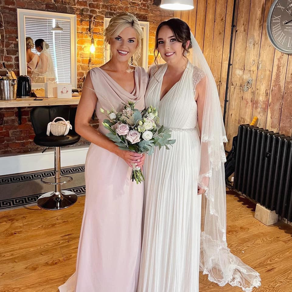Sophie and one of her many gorgeous bridesmaids.  Just look at the amazing bridal prep room we used at Stock Farm Barn (Tatton Weddings) In Altrincham! - Make Me Bridal Artist: Joanne Lucas Makeup Artistry. Photography by: Iphone Camera. #glamorous #bridesmaid #brideprep #glowingskin
