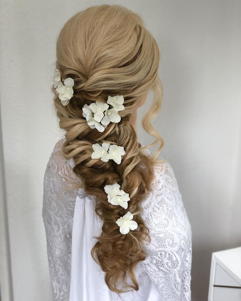 This style was created on long hair with added extensions.