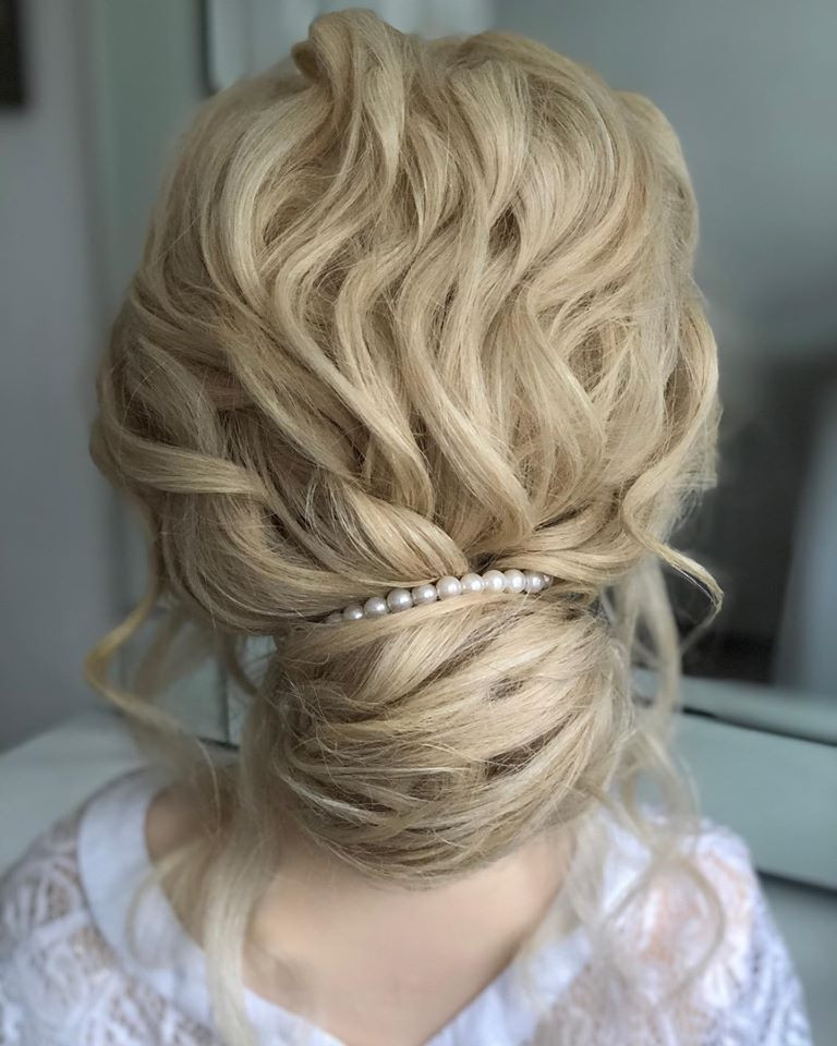 Long hair was curled quite tightly and then placed into the casual bun. A lovely relaxed style, which is one of my personal favourites. - Make Me Bridal Artist: Linda Loves Hair. #glamorous #boho