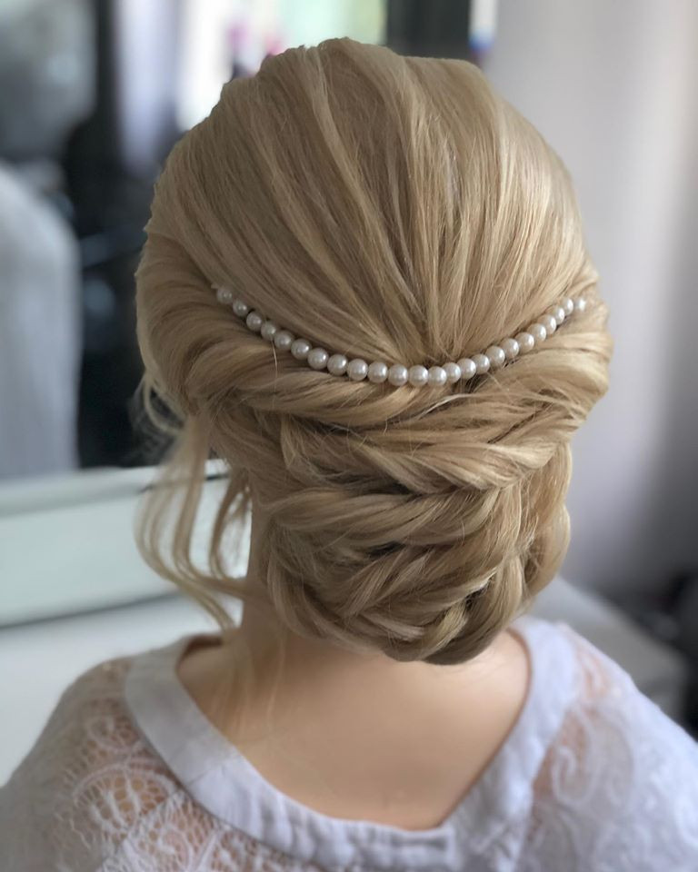 Braided updo, perfect for brides or bridesmaids. Hair is curled and then twists are added to the hair to create the look. - Make Me Bridal Artist: Linda Loves Hair. #classic