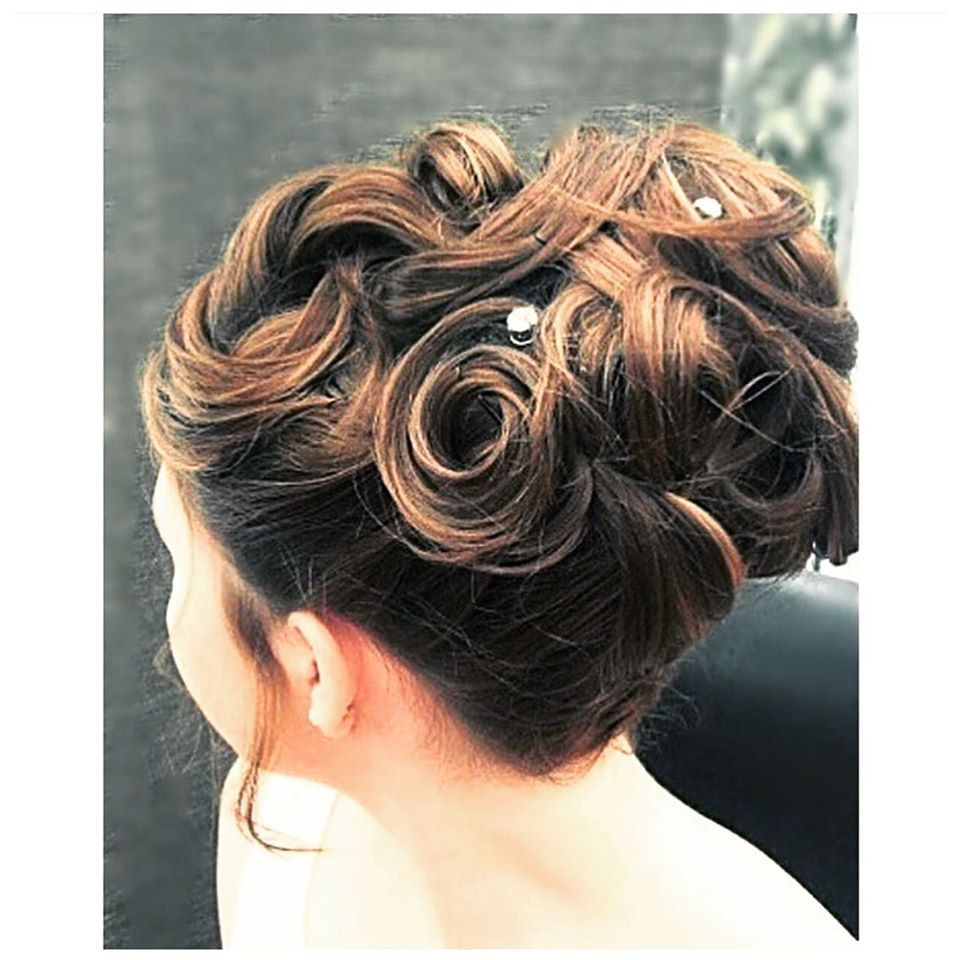 A classic high bun with curls and texture added. - Make Me Bridal Artist: Linda Loves Hair. #highbun #eleganthighupdo #curlybun