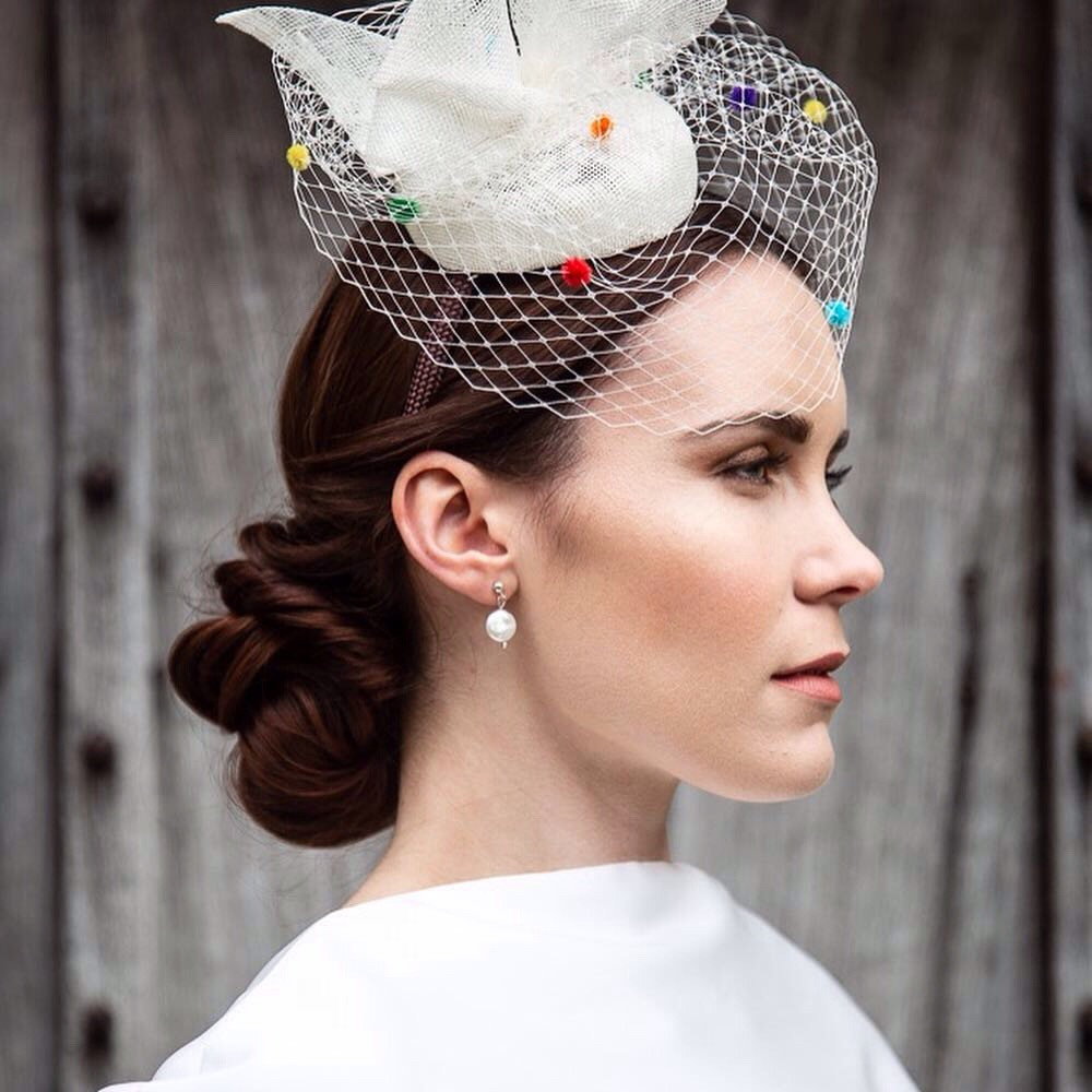 Contemporary bride wearing pill box hat with net - Make Me Bridal Artist: Makeup Angel. Photography by: John Knight. #classic #vintage #glamorous #naturalmakeup #bridalmakeup #glow #chignon #elegant #lashes #coolbride