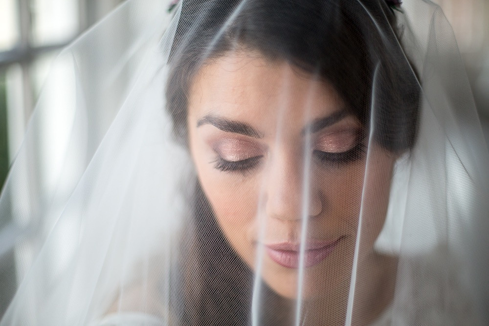 Beautiful bride with soft pink shimmering eye makeup with veil - Make Me Bridal Artist: Makeup Angel. Photography by: John Knight. #classic #boho #naturalmakeup #curls #bridalmakeup #elegant #perfectmakeup #makeup #bridalmakeupartist #veil #flawlessmakeup