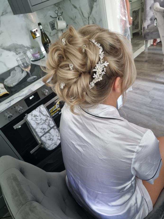 Beautiful soft, romantic high bun. - Make Me Bridal Artist: Alex hair and makeup. #bridalhair #romantichairup #hairup #highbun #bride #romanticstyle