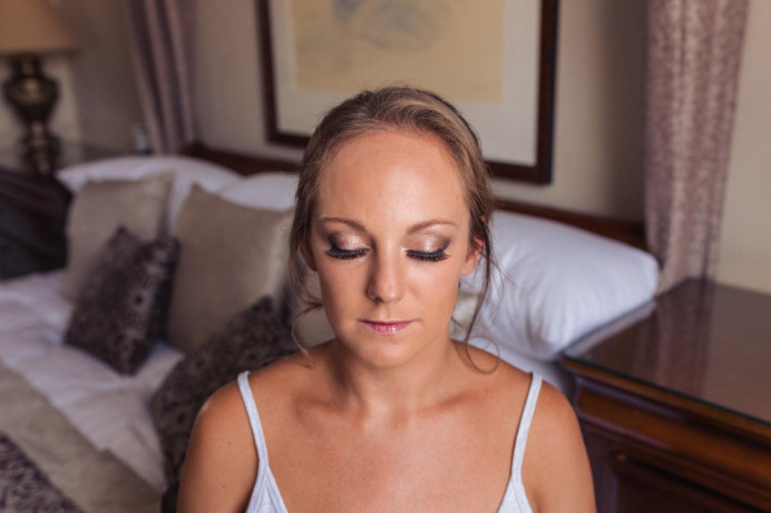 Beautiful soft golden tone bridal makeup, with a lip colour that enhanced the natural lips. Classic low bridal bun - Make Me Bridal Artist: Alex hair and makeup. Photography by: Photography by kirsty. #naturalmakeup #weddingmorning #gettingready #bridalhair #bridalmakeup #hairup #lowbun #weddinghair #weddinghairandmakeup