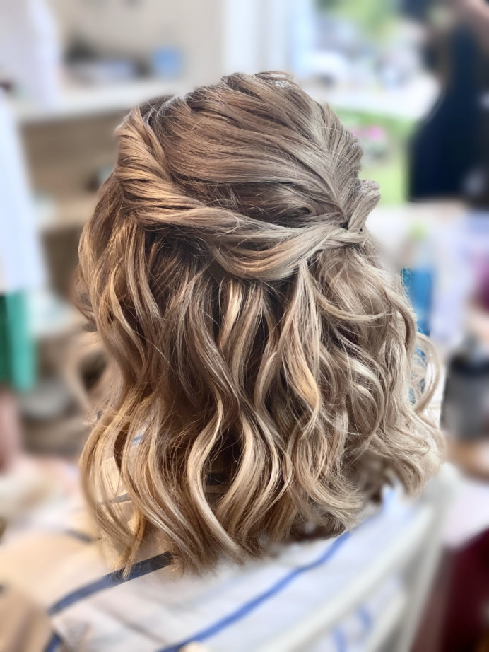 Textured beach waves for this lovely bridesmaid. Twisted detail to keep it modern and interesting - Make Me Bridal Artist: Carter Hair & Makeup. Photography by: Me. #boho #halfuphair #bridesmaidhair #bohobride #bohowedding #beachwaves #softcurls #twisteddowndo #halfuphalfdown