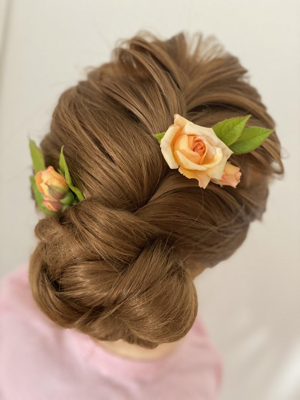 Beautiful boho style plait with bun up do on model - Make Me Bridal Artist: Abbi Parsley MUA. #bohemian #roses #flowersinherhair #flowers #bohobride #bohohair
