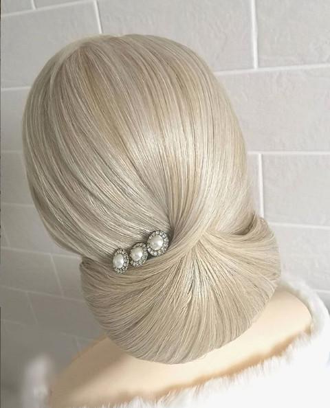 Bridal hair by Makeup By Nichola for the elegant Bride. - Make Me Bridal Artist: Makeup By Nichola. #vintage #glamorous #elegant #hairup #lowbun #bridalhair #brideshair #sophiscated
