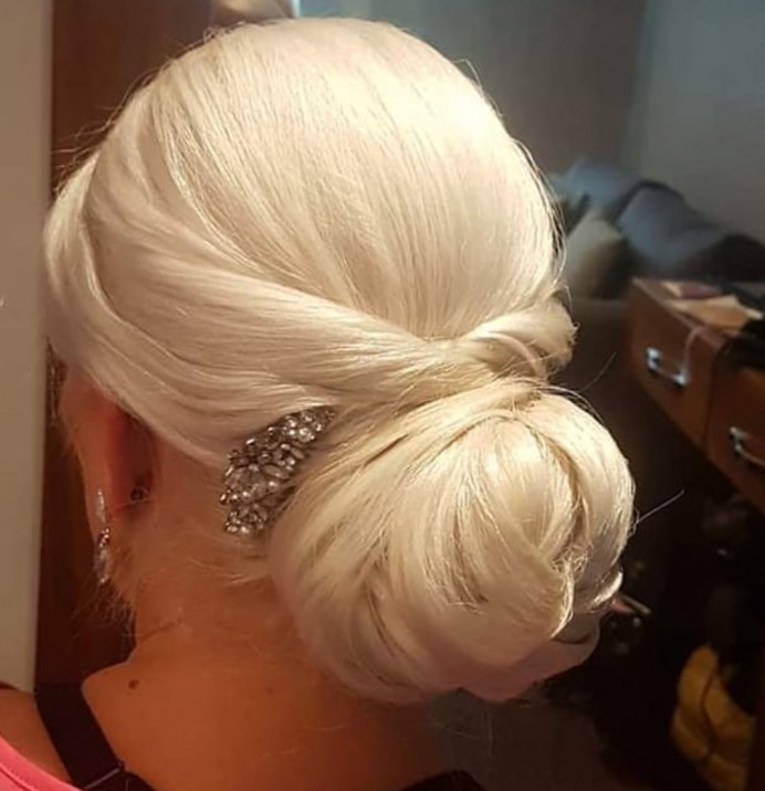 Lovely smooth elegant updo I created on a bridesmaaid at Lancashire Manor Hotel. - Make Me Bridal Artist: Hair Creations North West. #classic #chignon #bridesmaidhair #weddinghair #hairup #haircreationsnorthwest