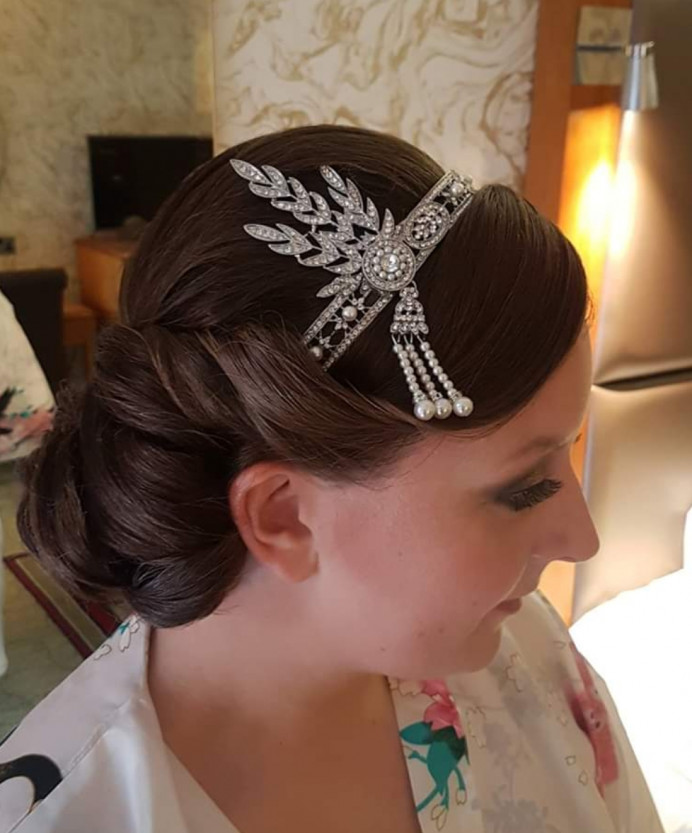 I love a challenge! Super sleek vintage bridal updo. My bride wished for a gatsby theme wedding so we worked with her gorgeous head piece to create this 1920s look for her perfect day. She looked amazing. - Make Me Bridal Artist: Hair Creations North West. #vintage #bridalhair #hairstyling #bride #sleek #vintagehair #weddingmorning #smoothupdo #weddings #mobilehairstylist #haircreationsnorthwest
