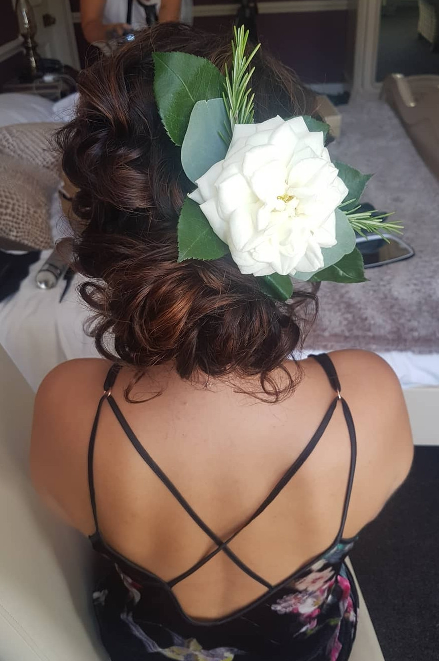 This is one of my favourite styles. My bride requested an effortless hairstyle nothing sleek and fixed. The flower clip finished it off really well. - Make Me Bridal Artist: Hair Creations North West. #curls #weddingmorning #bridalhair #flowersinherhair #updo #soft #elegant #pretty #tousled #relaxedupdo #mobileweddinghair