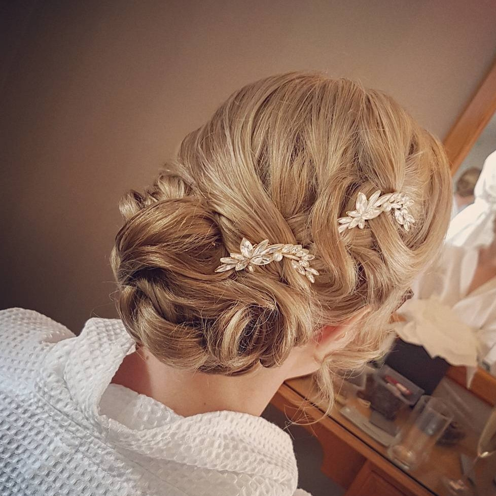 My brides wedding was in the Lake District. I love travelling to The Lakes! She went for something a little bit different to her original chosen style on the morning. It suited her so well! Bridal hair smooth elegant romantic updo. Few jewel clips to compliment the style perfectly. - Make Me Bridal Artist: Hair Creations North West. #classic #glamorous #blonde #weddingmorning #bridalhair #updo #elegant #romantichairup #lakedistrict
